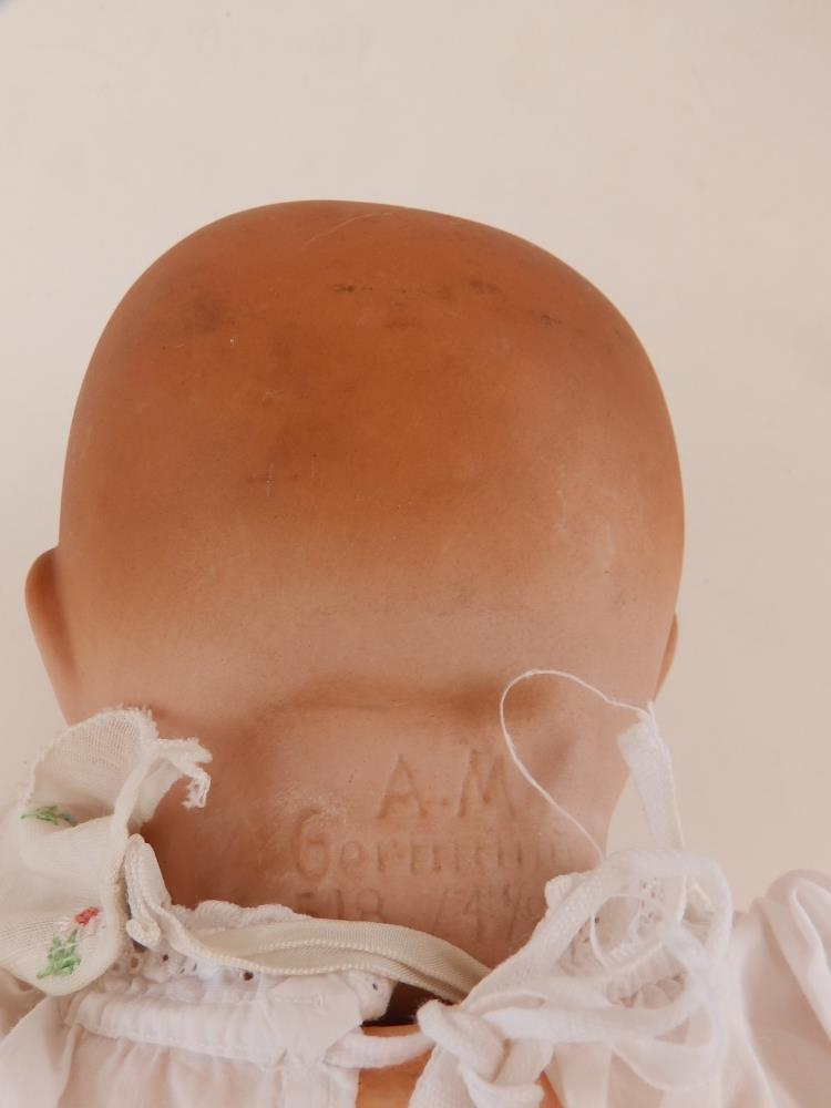An Armand Marseille bisque head baby doll with blue paperweight eyes, open mouth, composition body - - Image 3 of 3
