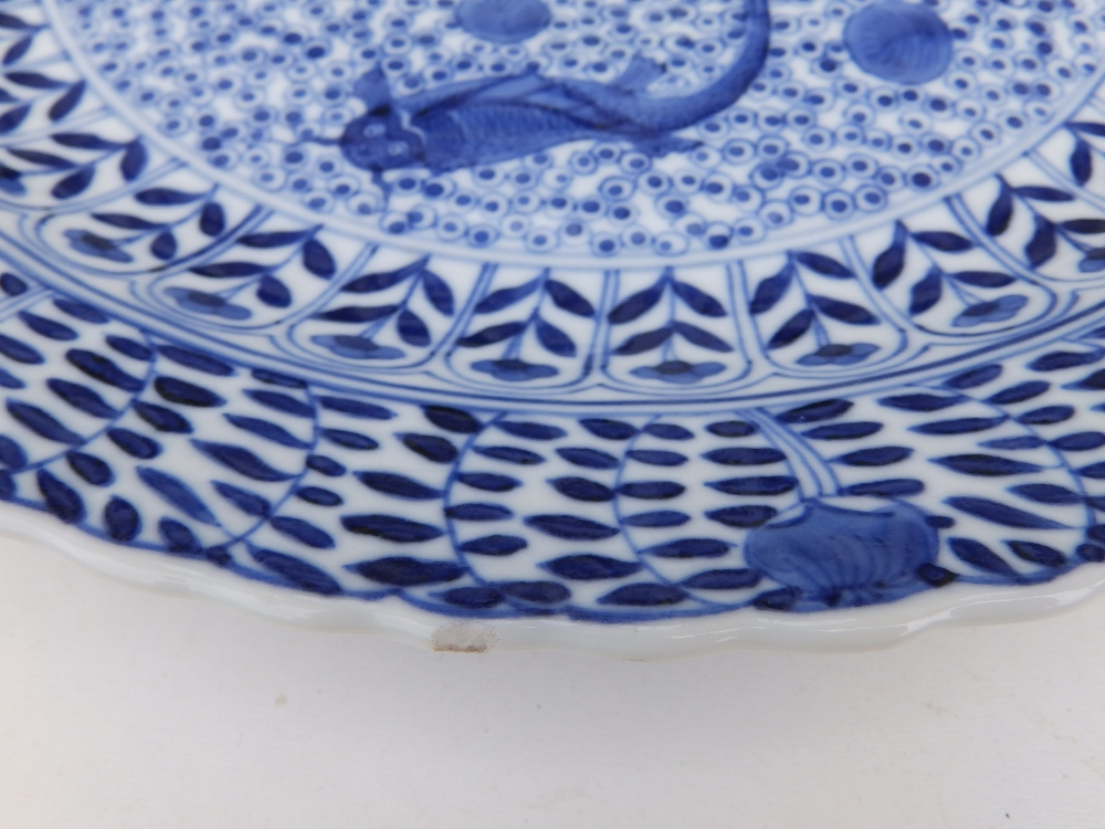A Chinese blue & white porcelain plate decorated with five small carp against an ornamental - Image 5 of 8