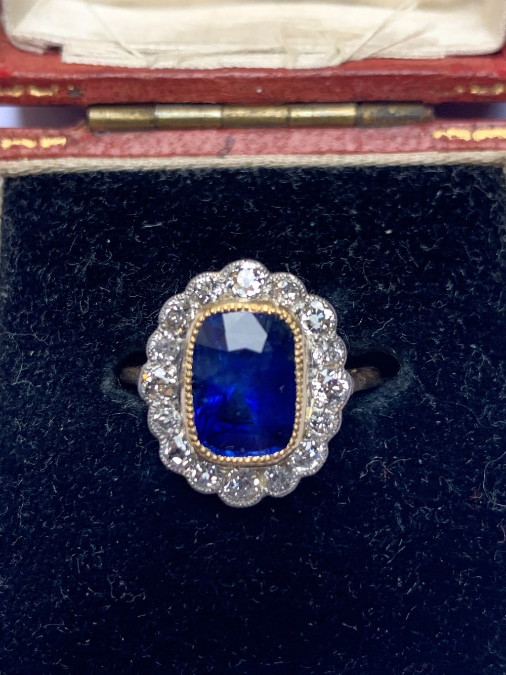 A certified natural 3.03 carat Sri-Lankan sapphire & diamond oval cluster ring in 18ct yellow