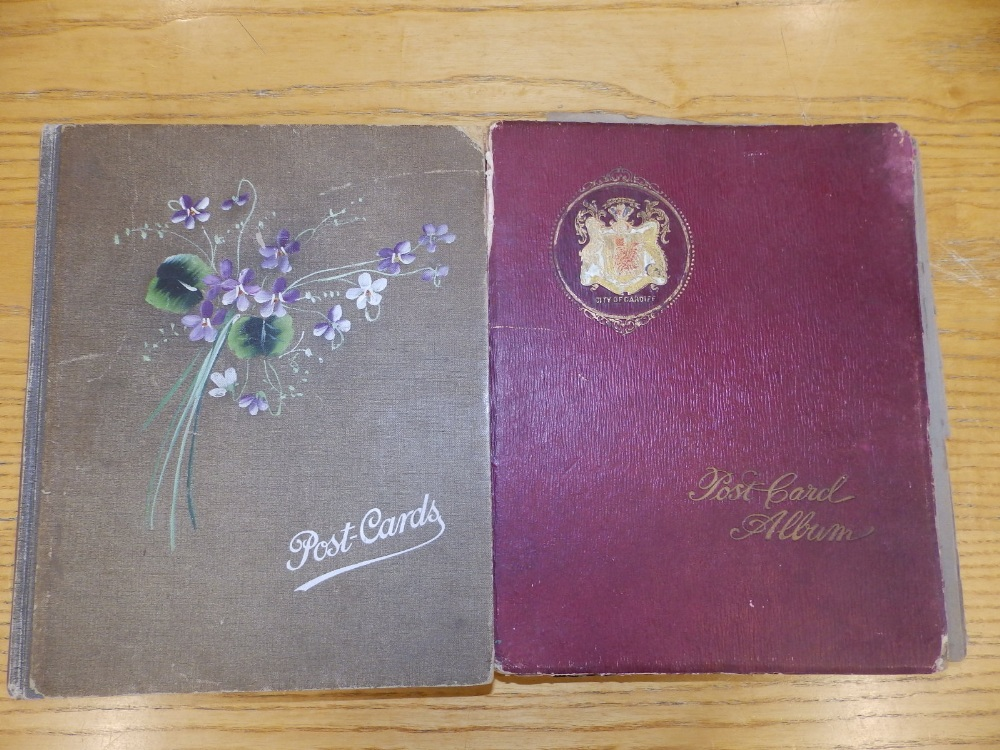 Two old postcard albums conatining approximately 200 cards including WWI subjects and humorous.