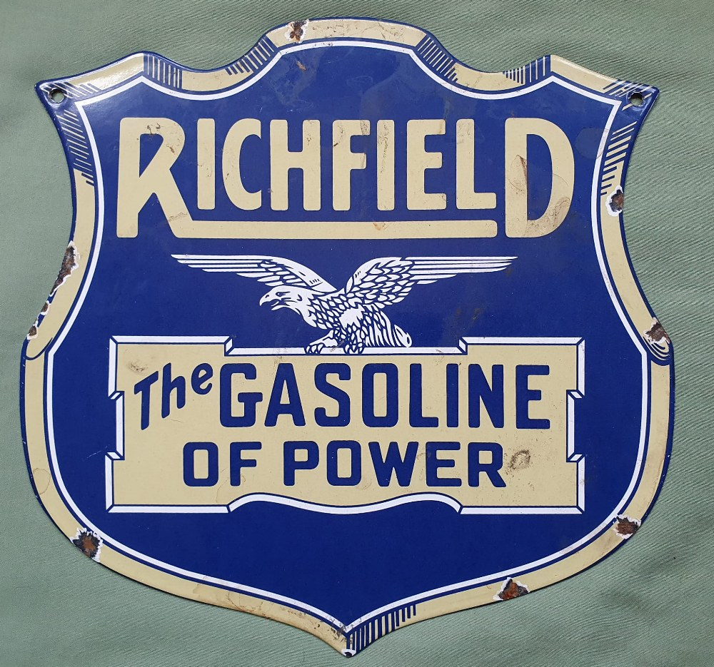 """A shield-shaped enamelled advertising plaque - 'Richfield, The Gasoline of Power', 12"""" high."""