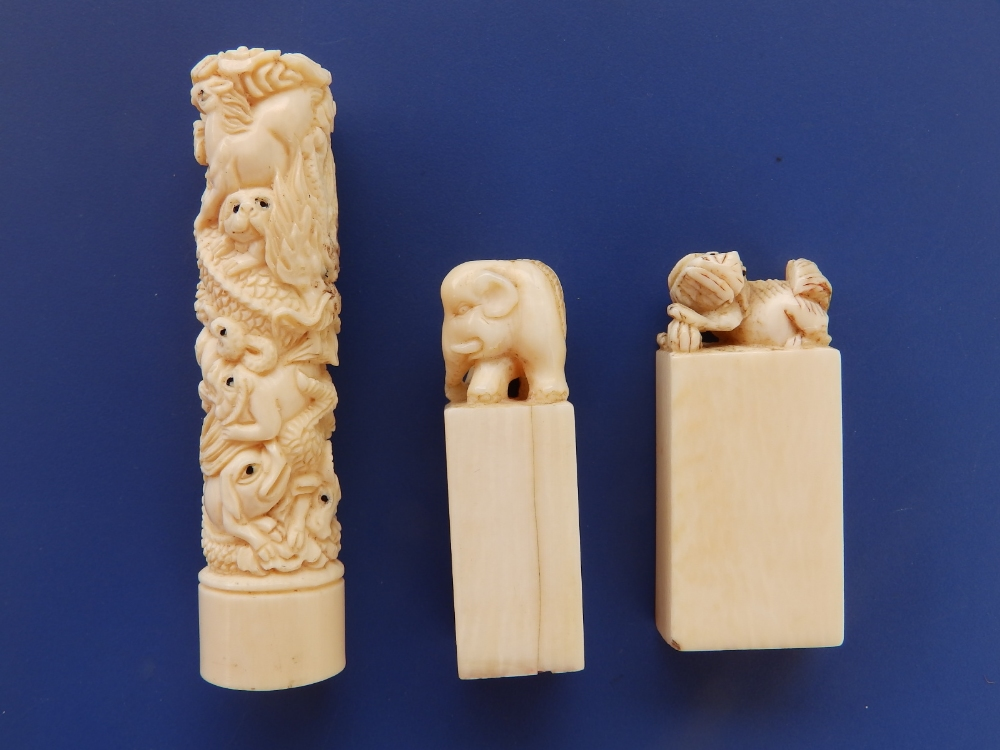 Two late 19th/early 20thC Chinese ivory desk seals, one with an elephant, the other with a