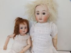 """A French bisque head girl doll with brown glass eyes - 'AL & Cie, Limoges. Cherie 7', 20"""""""