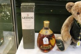 2017 bottle of Ledaig Single Malt Whisky and a bottle of Dimple Deluxe Scotch Whisky