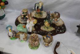 Nine Beatrix Potter Beswick characters and stand