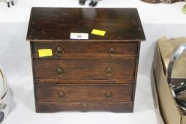Early 20th century miniature chest of drawers, 23 cm wide, 14 cm deep,