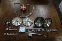 Box of vintage car parts and badges, British Leyland, Hillman Hunter, Laird,