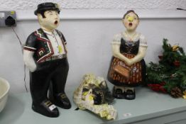 Two papier mache figures, height 53 cm and a face mask.