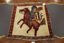 Wool wall hanging of a mounted archer 54 x 56 cm
