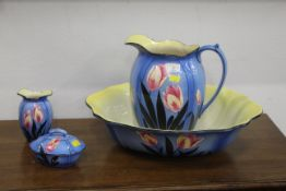 Four piece toiletry set, floral decoration on blue background, Falcon Ware Made in England.