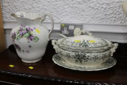 Late 19th century/early 20th century water jug 28 cm high, and early 20th century tureen with base,