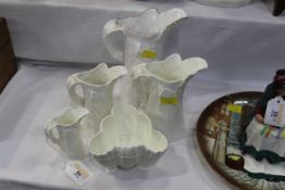Four Royal Worcester fern leaf pattern jugs and Worcester shell shaped dish