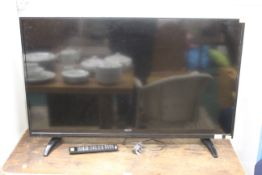 """42"""" flat screen television set (straight from used) with remote control."""
