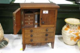 Miniature set of drawers with double doors above with built in mirror and drawers, width 26.