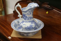 Blue and white oriental patterned jug (30 cm high) and bowl (35 cm diameter)