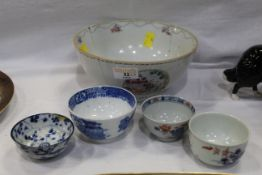 Four oriental tea bowls and a late 19th century oriental bowl