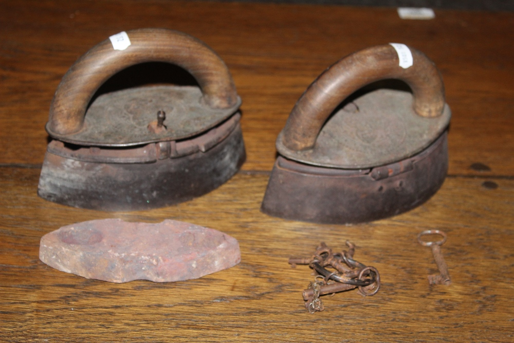Two antique elliptical form box irons, w