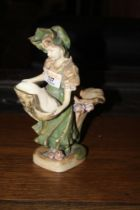 An Austrian figural vase, decorated and