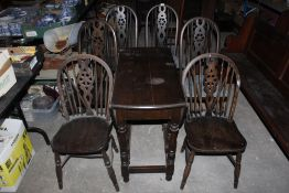 A set of four stained elm seated wheel b