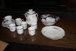 A box containing two part tea sets, one
