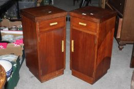 A pair of 1930's walnut bedside cupboard