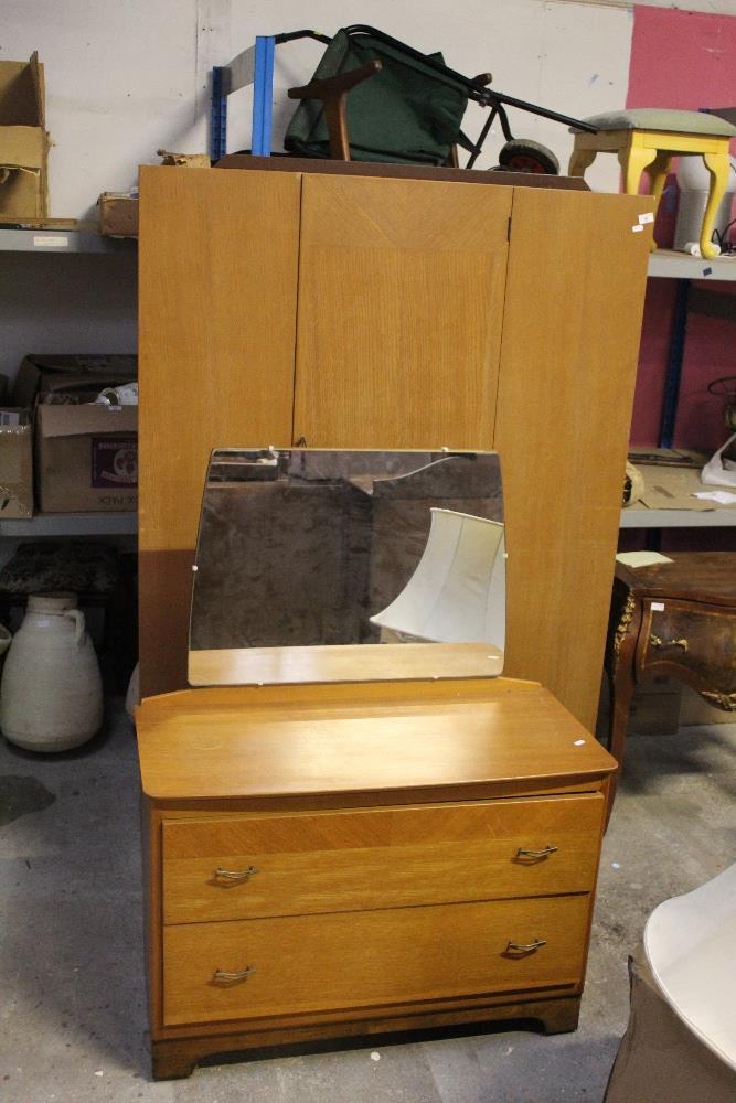 A mid century light oak two piece bedroo