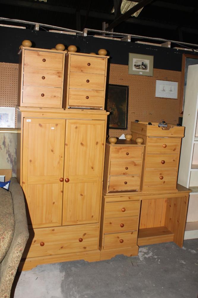 A modern pine effect six piece bedroom s