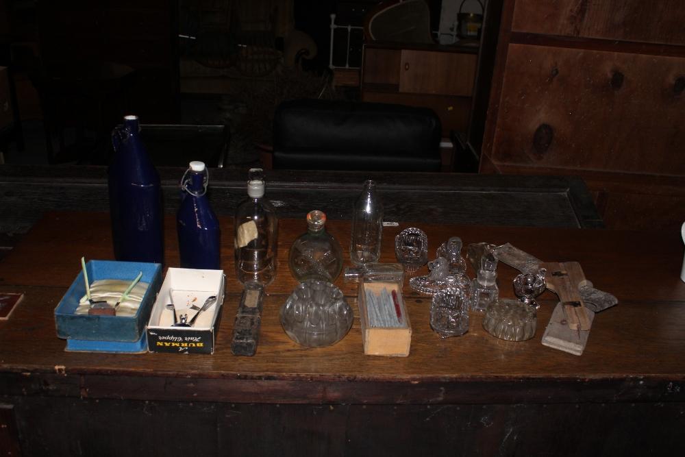 Two vintage blue enamelled flasks, one r