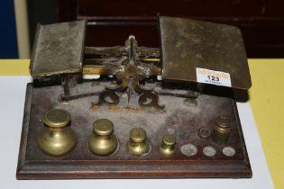 A set of Victorian brass and mahogany po