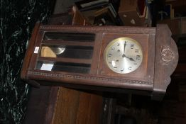 A 1930's /40''s oak wall clock, with Ara