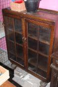 A glazed oak display case or bookcase, c