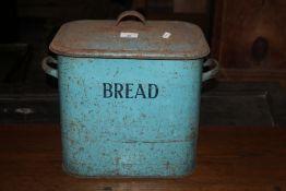 A vintage blue enamelled bread bin, of t