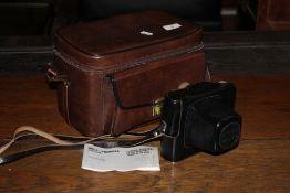 A Zenit EM SLR camera wirth lens and lea