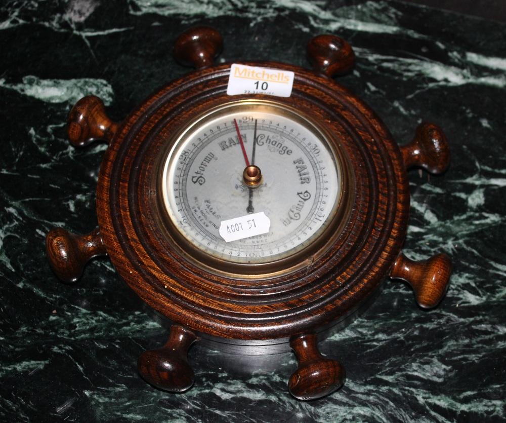 A early 20th century walnut aneroid baro