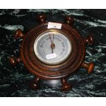 A early 20th century walnut aneroid baro