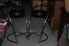 Two chromed bar stools, with leather eff