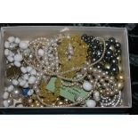 A box of miscellaneous costume jewellery
