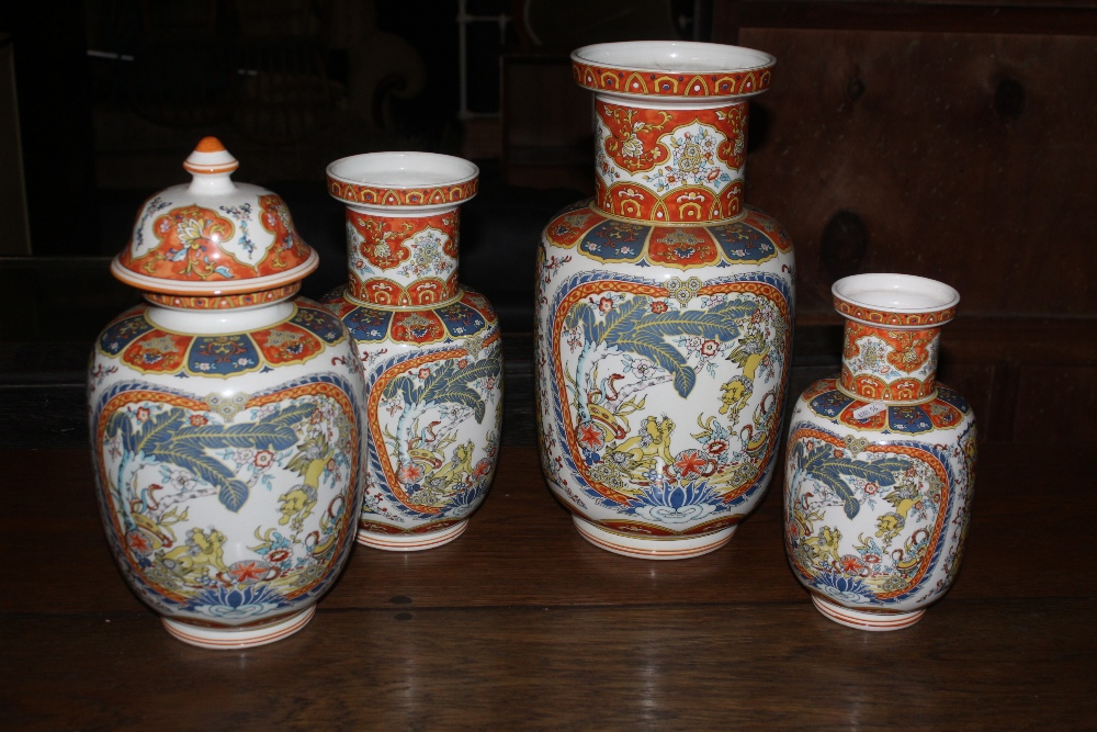 A group of four reproduction Chinese vas