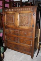 A reproduction oak tallboy chest, with m