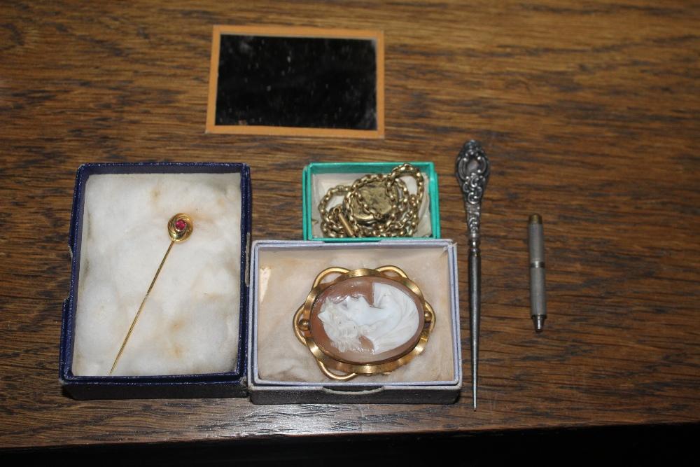 A garnet set yellow metal stick pin, a y