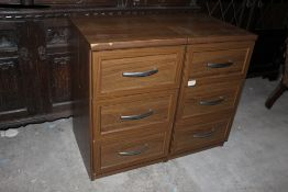 A pair of modern laminate bedside chests