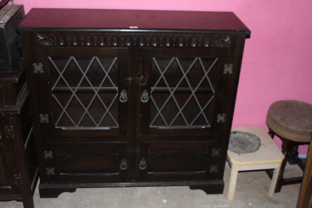 A 1980's stained oak display cabinet, or
