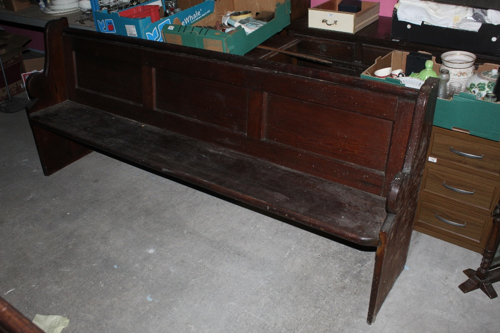 A pitch pine church pew, of traditional