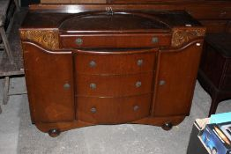 A 1940's oak bow fronted sideboard, the