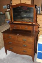 An Edwardian mahogany dressing chest, wi