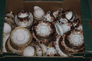A box containing two part tea services,