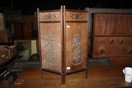 An early 20th century oak and decorated