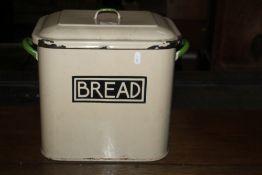 A vintage cream enamelled bread bin, of
