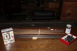 Two bundles of stair rods, together with