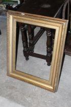 A swept gilt picture frame, 83 cm x 65 c